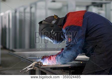 Welder Working On Factory, Welding Work. Erecting Technical Steel Industrial Craftsman On Plant.