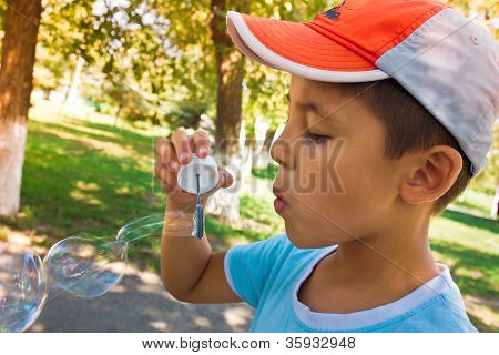A Little Boy Playing With Bubbles