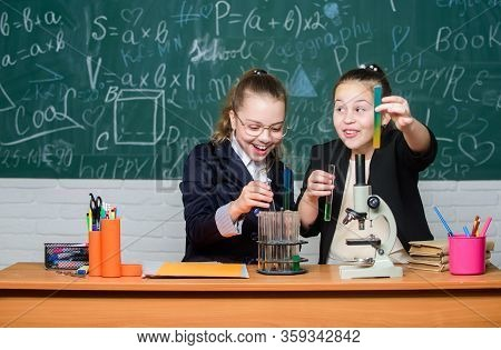 Travel The World With Science. Little Girls Genius In School Lab. Science Lab. Science Experiments I