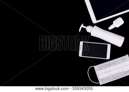 Home Work Space Organized With Lap Top, Pad, Sanitizer And Protective Mask . Work In The Office Or A