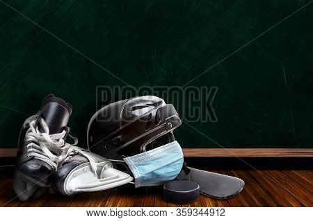 Ice Hockey Helmet Wearing Surgical Mask On A Background Chalk Board With Copy Space For Text. Concep