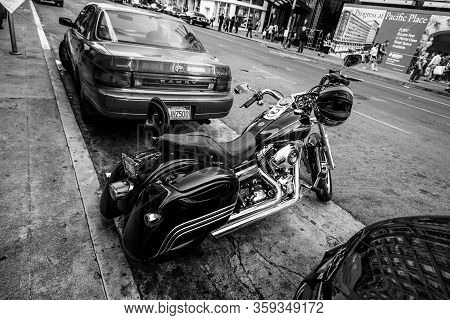 San Francisco, Usa - Sept 30, 2012: Harley Davidson Super Glide Motorcycle With Helmet On The Handle