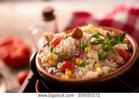 Rice Salad In A Bowl On Wooded Table