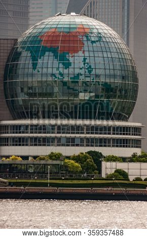 Shanghai, Pudong, Lujiazui, China - May 4, 2010: Closeup Of Giant Glass Globe Replica On Side Of Int
