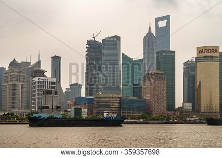 Shanghai, Pudong, Lujiazui, China - May 4, 2010: Skyline Of Tall Buildings Under Silver-smog-brown S