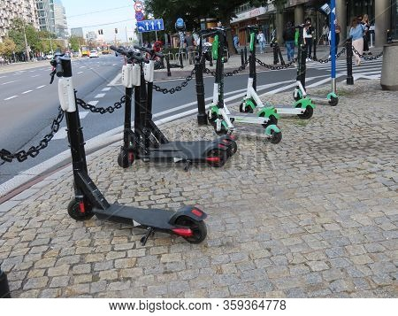 Warsaw, Poland - September 11, 2019. Shared Electric Scooters Parked On The Side Of Main Street, Wai