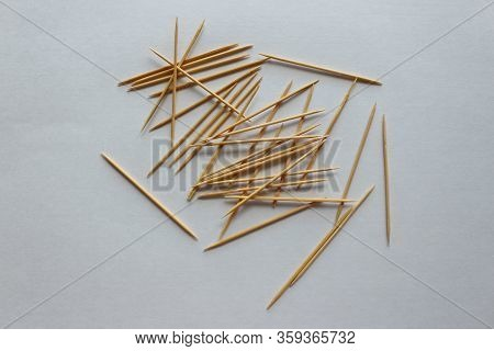 A Detailed Of Toothpicks On A White Background. A Close-up Photo Of An Isolated Object. On A White B