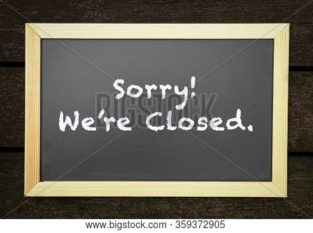 Sorry, We Are Closed, Words On Blackboard, Business Shut Down Or Closing Concept.