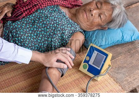 Doctor Measured The Pressure Of The Elderly,senior Woman Patient And Doctor With Tonometer Measuring