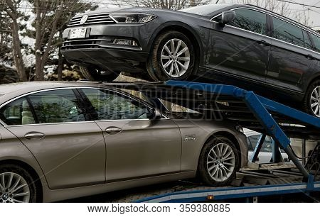 Bucharest, Romania - March 02, 2020: A Bmw 520d Car And A Volkswagen Passat B8 Highline Variant Are