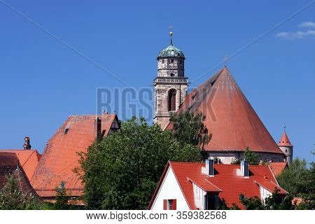 DINKELSBUHL, GERMANY - JULY 15, 2006:  St.-Georgs-Kirche church tower with sky