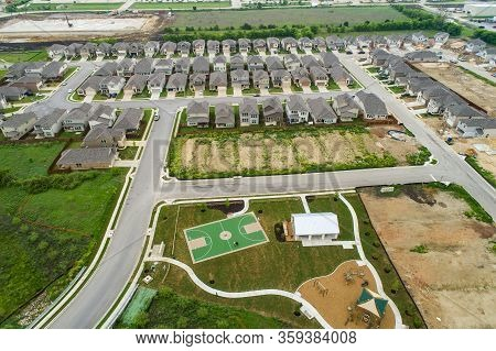 Aerial Drone Views High Above Suburb New Development Homes And Houses Built With Park And Playground