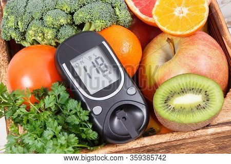 Glucose Meter With Natural Healthy Fruits And Vegetables. Concept Of Checking Sugar Level, Diabetes,
