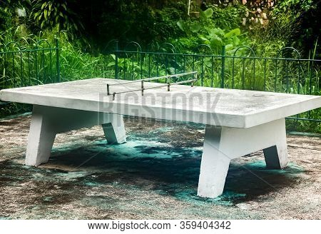 Old Tennis Table In Park Made Of Whole Concrete, Stable And Massive For Playing Ping Pong