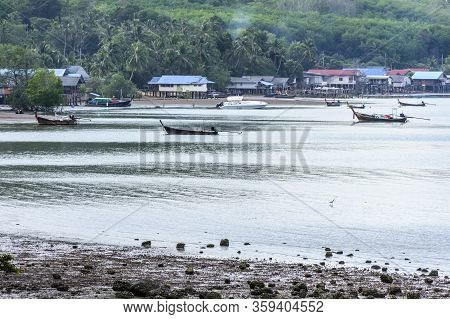 Ko Yao Noi, Phang-nga Bay, Thailand -  March 18, 2020: Long-tail Boats & Speed Boat Anchored In Fron