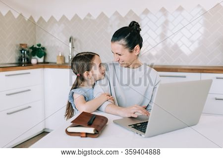 Happy Mother And Child Girl Make Purchases In The Internet On Black Friday. Holiday Shopping Online.
