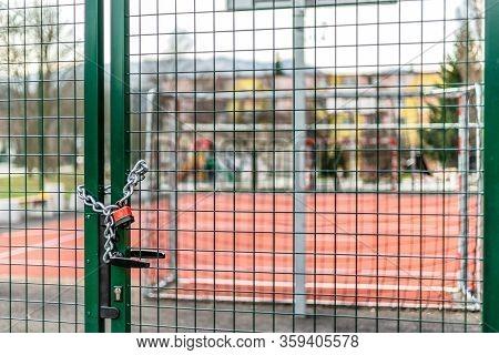 Closed Basketball Court And Children Playground. Coronavirus Covid-19 Restrictions