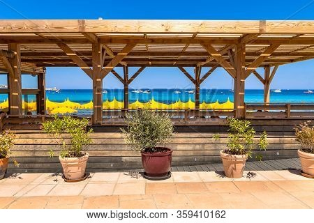 Beach Restaurant With Pergola And Green Plants For Shady Conditions On Corsica Boulevard, France.