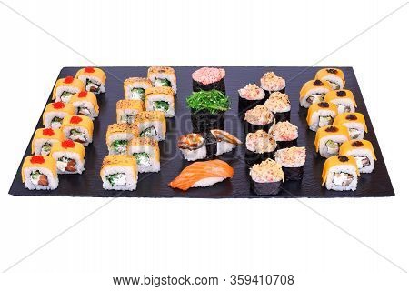 Sushi Set Cheese Rolls With Fresh Fish And Cheese Inside . Rolls On Black Stone Isolated On White Ba