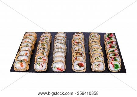 Sushi Set With Fresh Ingredients On Black Stone Isolated On White Background. Different Types Of Hot