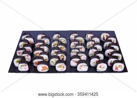 Maki Sushi Set Futomaki Rolls With Fresh Ingredients. Rolls On Black Stone Isolated On White Backgro