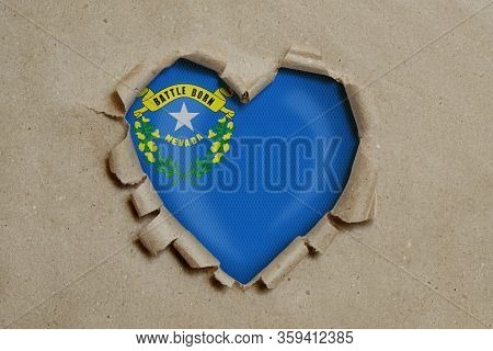 3d Illustration. Heart Shaped Hole Torn Through Paper, Showing Nevada Flag