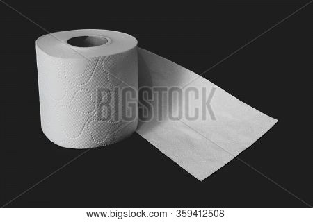 Unwrapped White Toilet Paper Roll On Black Matte Background With Copy Space