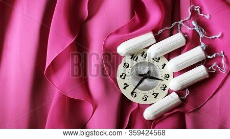 Women's Sanitary Tampons And Clock On A Pink Dress, Hygiene Products.