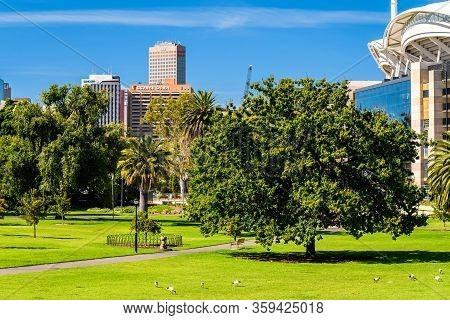 Adelaide, Australia - February 23, 2020: Adelaide City Skyline Viewed Through Pennington Gardens On