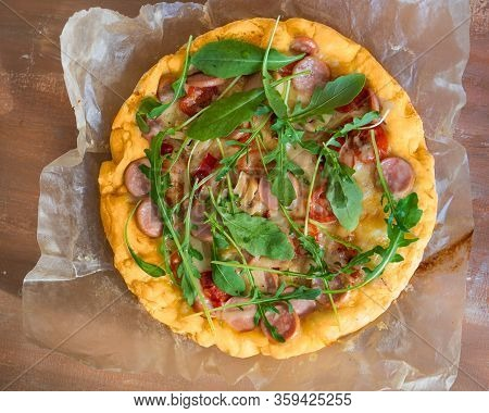 Home-made Pizza With Sausage, Tomatoes And A Cutaway, Mushrooms And All-season Arugula