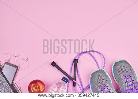 Fitness Sports Equipment And Accessories On Pink Background, Flat Lay With Copy Space. Home Online W
