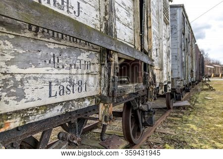 Old Train Carriages On Rails, Red And White Wooden Train Carriages. Low Angle Photography