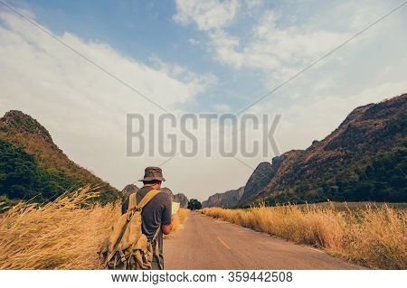 Adventurer Holding Binoculars For Bird Watching And Hiking Trail In The Forest And Cave. Outdoor Act