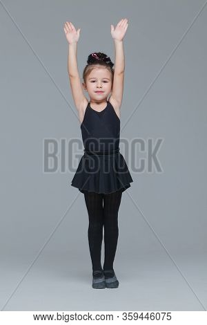 Beautiful Little Girl Gymnast In Black Sportswear Is Going To Become Ballet Dancer And Shows Exercis