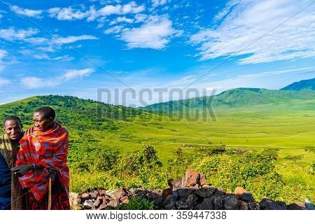Ngorongoro Crater, Tanzania, Africa - March 5, 2020:. Locals Standing By The Side Of The Road In Ngo