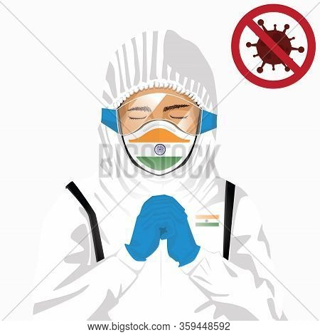 Covid-19 Or Coronavirus Concept. Indian Medical Staff Wearing Mask In Protective Clothing And Prayin