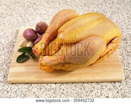 A Whole Corn Fed Raw Chicken Preparation Of A Whole Corn Fed Raw Chicken With Onion, Garlic And Herb