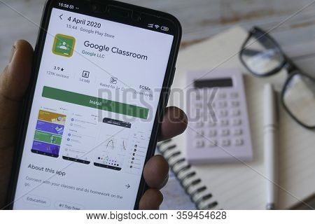 Kulim,malaysia - April 4th,2020 : A Hand Holding Mobile Phone With An Android Application Of Google