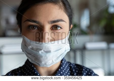 Serious Cautious Indian Ethnic Woman In Protective Medical Mask.