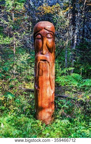 Wooden Sculpture In The Forest
