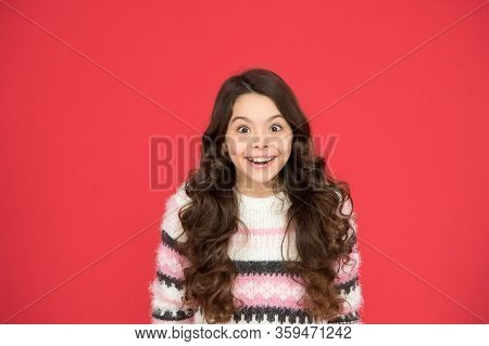 Amazing. Kid Girl Long Hair Posing Confidently. Girl Curly Hairstyle Feels Confident. Child Psycholo