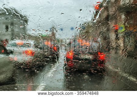 View Of Nevsky Prospekt Through The Rain-drenched Car Window On A Cloudy Summer Day. The Focus Is In