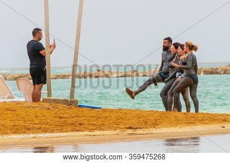 Young People Covered With High-mineral Dead Sea Mud