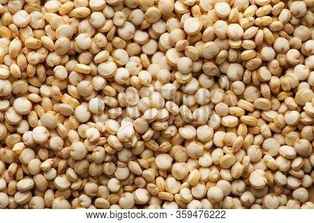 Dry Quinoa Croup Closeup In Full Frame. Quinoa Photo For Recipes, Grocery Departments, Logo. Quinoa