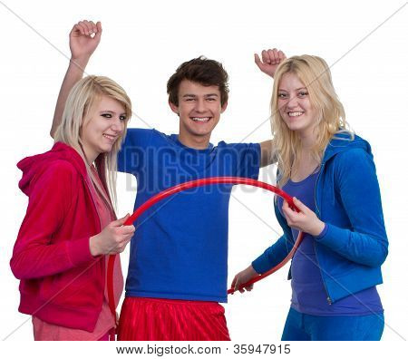 Three Teenagers With A Sports Hoop