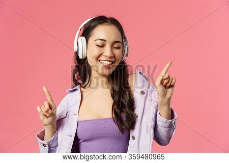 Lifestyle, Music And Technology Concept. Close-up Portrait Of Carefree, Happy Smiling Asian Woman En
