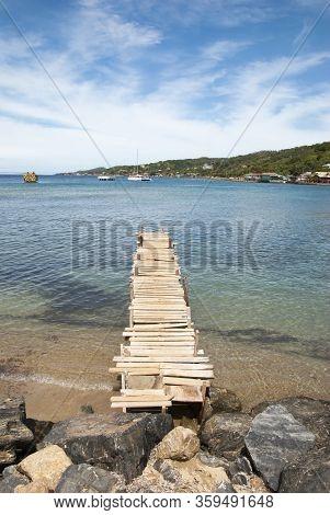 The Wooden Pier In Coxen Hole Town On Roatan Island, Popular Port Of Call In Caribbean (honduras).
