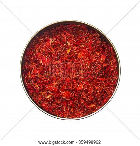 Red Dried Safflower Petals In A Tin Can. Isolated On A White Background.