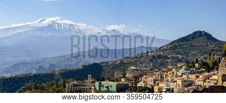 Panorama Of Taormina City, Sicily, Italy With Etna Volcano In The Background