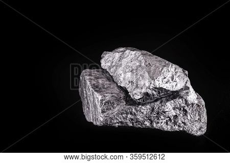 Small Titanium Stone, Metal Used In Light Alloys. Macro Photography Of Rough Ore.